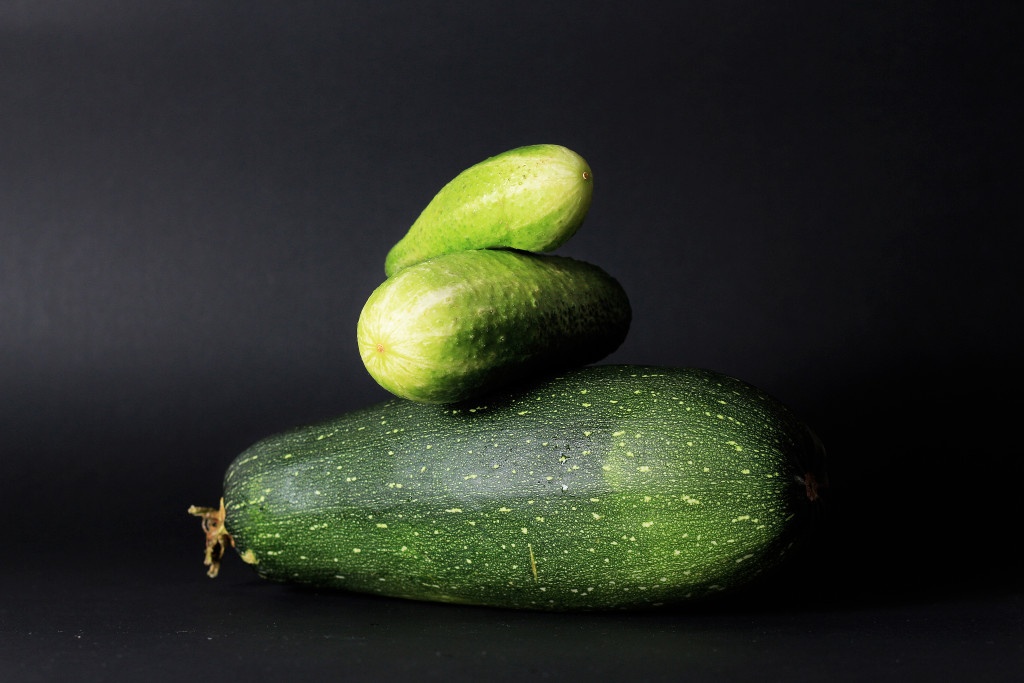 Fresh green zucchini on a black background